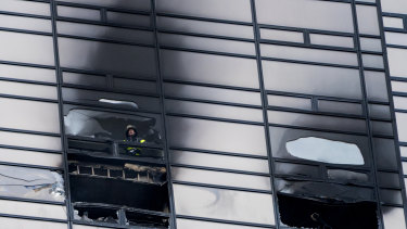 A firefighter inside Trump Tower.