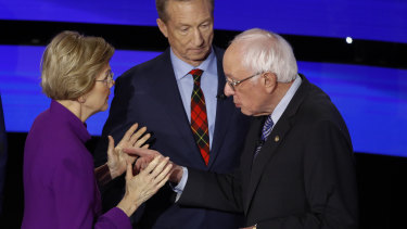 Democratic presidential candidates Elizabeth Warren and Bernie Sanders share a tense moment after the debate.