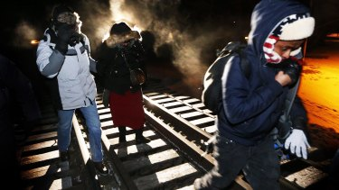 Eight migrants from Somalia cross into Canada illegally from the US by walking down a train track into the town of Emerson, Manitoba, in 2017. Migrant numbers have decreased since the outbreak of coronavirus.