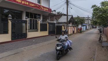 Men drive past a mosque where Zaharan Hashim used to preach in Kattankudy.