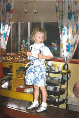 Amy aged three in overalls and frilly  socks, a childhood favourite.