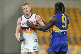 Reilly O'Brien holds a new phone courtesy of Nic Naitanui after their match earlier this year.