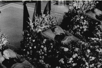 Russia's three Soyuz-11 cosmonauts lie-in-state, surrounded by masses of flowers, in Moscow's Central House of the Soviet Army. They are, left to right: Viktor Patsayev, 33, Vladislav Volkov, 37, and Lt. -Col. Georgi Dobrovolsky, 43, July 1, 1971.