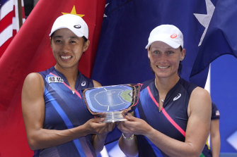 Zhang Shuai and Samantha Stosur with the US Open women's doubles trophy.