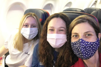 Sandy Duffield with her daughters Luca, 16, and Zara, 13 on the flight home.