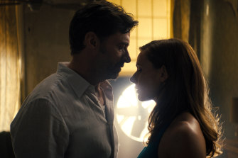 Hugh Jackman, left, and Rebecca Ferguson in a scene from Reminiscence.