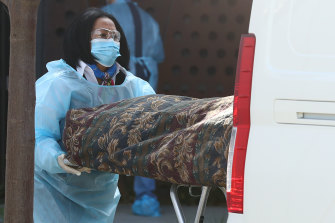 A body is removed from Epping Gardens aged care home on Wednesday.