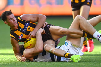 Hawks star Jaeger O'Meara is tackled during the Easter Monday clash with Geelong at the MCG.