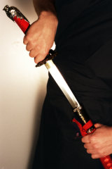 A woman has been charged after allegedly injuring a man with a Samurai sword in Sydney's west.