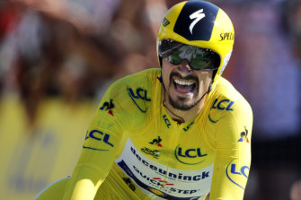 Julian Alaphilippe crosses the line to extend his lead over Geraint Thomas.