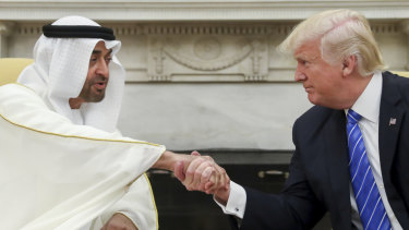 US President Donald Trump shakes hands with Abu Dhabi's crown prince, Sheikh Mohammed bin Zayed al-Nahyan, in the White House in Washington in 2017.