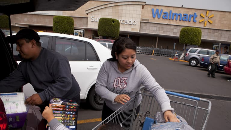 Shoppers unload groceries at a Walmart store in Mexico City.