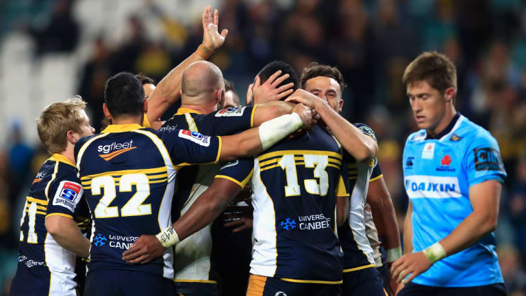 The Brumbies celebrate victory against the Waratahs.