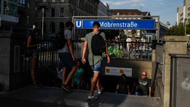 Pedestrians at the entrance of the subway station at Mohrenstrasse, or Mohren Street, Berlin. Activists are calling to rename the street, as Mohren is generally considered a racist insult referring to dark-skinned people.