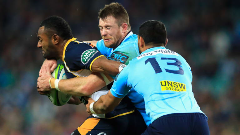 Head of steam: Jed Holloway and Curtis Rona try to drag down Tevita Kuridrani.