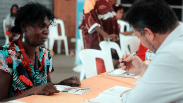 A Palm Island resident works with an ICAN financial counsellor. ICAN wants to see finance hubs set up in remote locations as part of a national strategy.