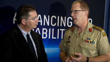 UNSW vice-chancellor Ian Jacobs,, and Deputy Chief Information Warfare Maj-Gen Marcus Thompson.