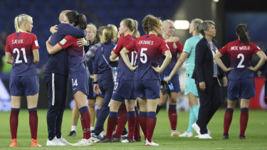 Norway players and officials console each other after the 3-0 loss to England.