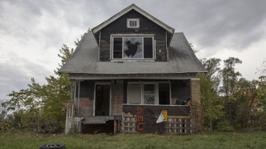 An abandoned home in Detroit. Barclays Bank settled law suits for much less than the Justice Department initially demanded.