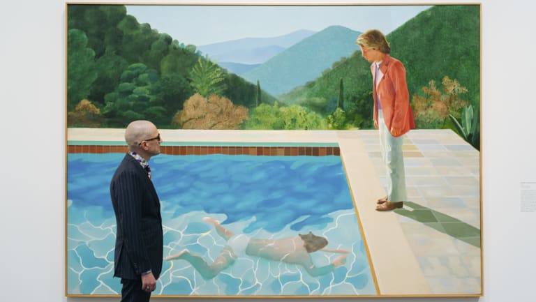 A viewer looks at David Hockney's Portrait of an Artist (Pool with Two Figures) at a retrospective exhibition last year.