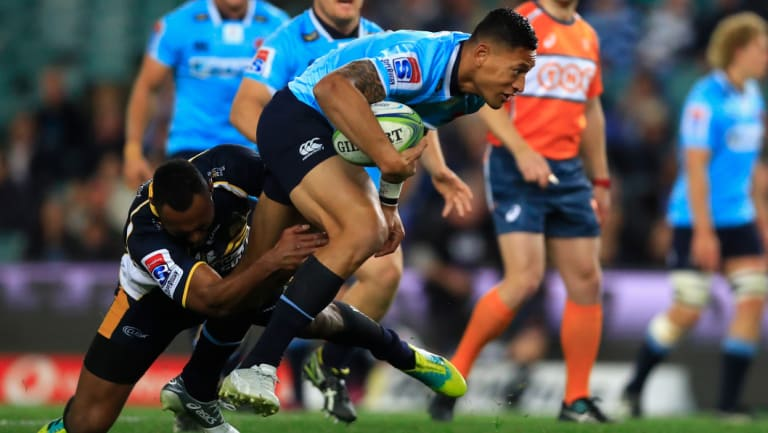 Hard yards: Israel Folau attempts to give the Waratahs some momentum.