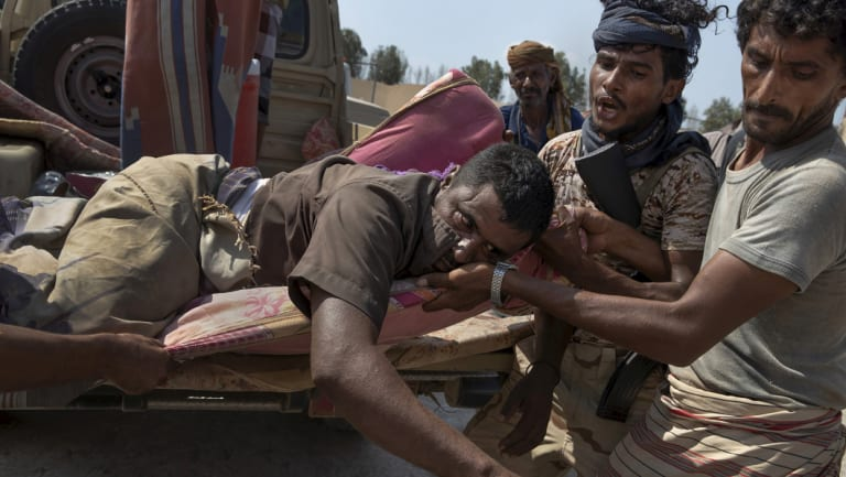 An injured Yemeni fighter with the Saudi Arabia-led Arab coalition, which is battling Iran-backed Houthis for control of Yemen, arrives at a field hospital.