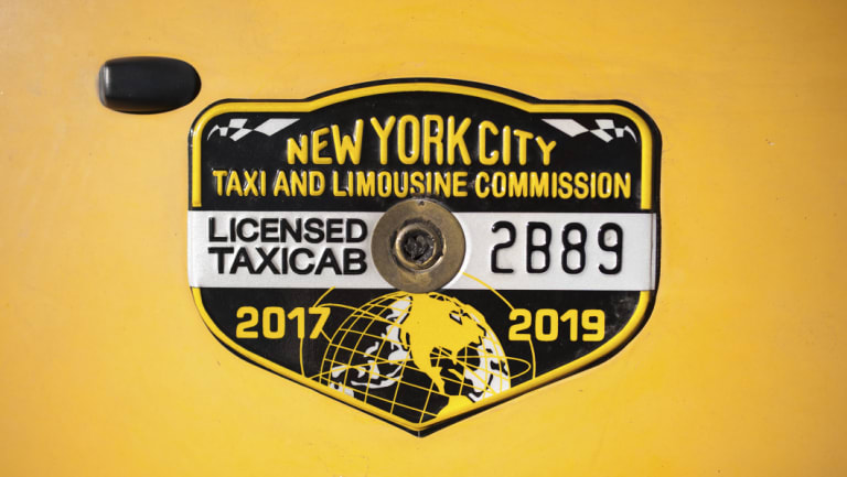 The taxi medallion that Nicanor Ochisor bought nearly three decades ago.