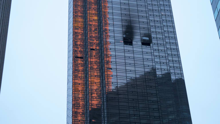 Fire damage can be seen at Trump Tower after a fire broke out on the 50th floor.