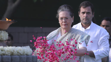 United Progressive Alliance chairperson Sonia Gandhi, centre, and her son and Congress Party president Rahul Gandhi pay homage to former Indian prime minister Rajiv Gandhi.