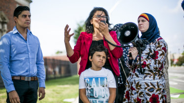 Rashida Tlaib with her family at a protest outside an Immigration and Customs Enforcement detention facility in Detroit earlier this month.