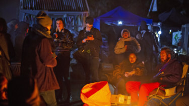 Protesters gather around a fire at the Ihumatao protest site.