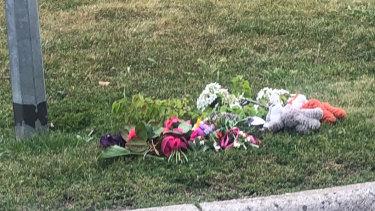 Flowers and toys left on Kiwi Retreat on Sunday.