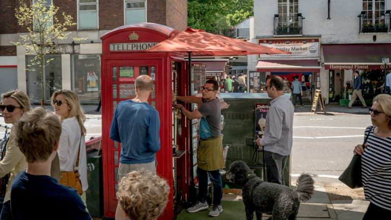 A new generation of phone boxes is replacing the iconic red ones, which have been either removed or, in this case, repurposed.