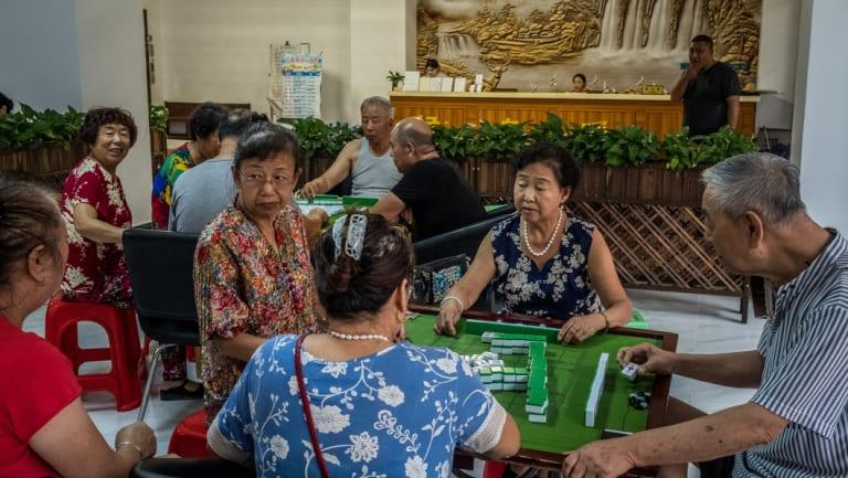 Playing mahjong at the Nuanchao Snowbirds Retirement Apartment in Sanya, China.