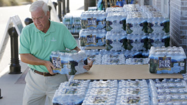 Larry Pierson purchases bottled water in Isle of Palms, South Carolina, in preparation for hurricane Florence.