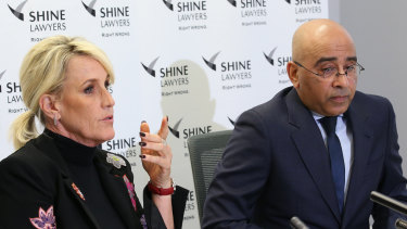 Ms Brockovich speaks with lawyer Roger Singh at a press conference at Shine Lawyers in Brisbane on Monday.