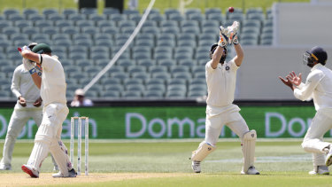 Gloved: Indian wicketkeeper Rishabh Pant sets himself for the catch to dismiss Aaron Finch on day four.