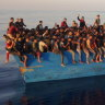 Decrepit smuggling boat packed with 539 migrants found off Italy