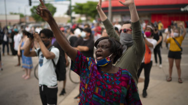 Demonstrators chant at police officers outside the Minneapolis police 3rd Precinct in Minneapolis on Wednesday.
