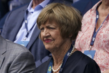 Margaret Court watches the clash between  Novak Djokovic and Diego Schwartzman on Sunday. Court's calendar-year grand slam will be honoured on Monday.