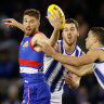 Dogs climb into top spot, Naughton concussed in win over Roos