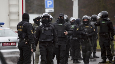 Belarusian riot police gather to block demonstrators during an opposition rally to protest the official presidential election results in Minsk, Belarus.