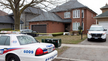 Police cars parked outside of of the Toronto area home of Alek Minassian in Richmond Hill, Ontario in 2018.