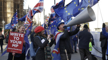 Demonstrators outside Parliament in London on Tuesday.