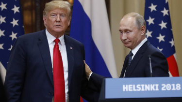 US President Donald Trump, left, and Russian President Vladimir Putin after their summit.