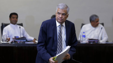 Sri Lankan Prime Minister Ranil Wickremesinghe leaves after testifying on Tuesday.