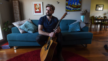 Busker Simon Paparo misses the interaction with passers-by in Bourke Street Mall.