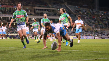 Jamal Fogarty of the Titans adds to the Raiders' misery in Canberra.
