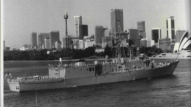 HMAS Sydney steams up-Harbour towards circular Quay for the first time.