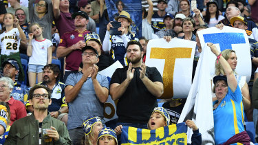 Standing ovation: Fans applaud Johnathan Thurston at the seven-minute mark of the game.